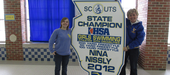 Nina and her coach with IHSA championship banner