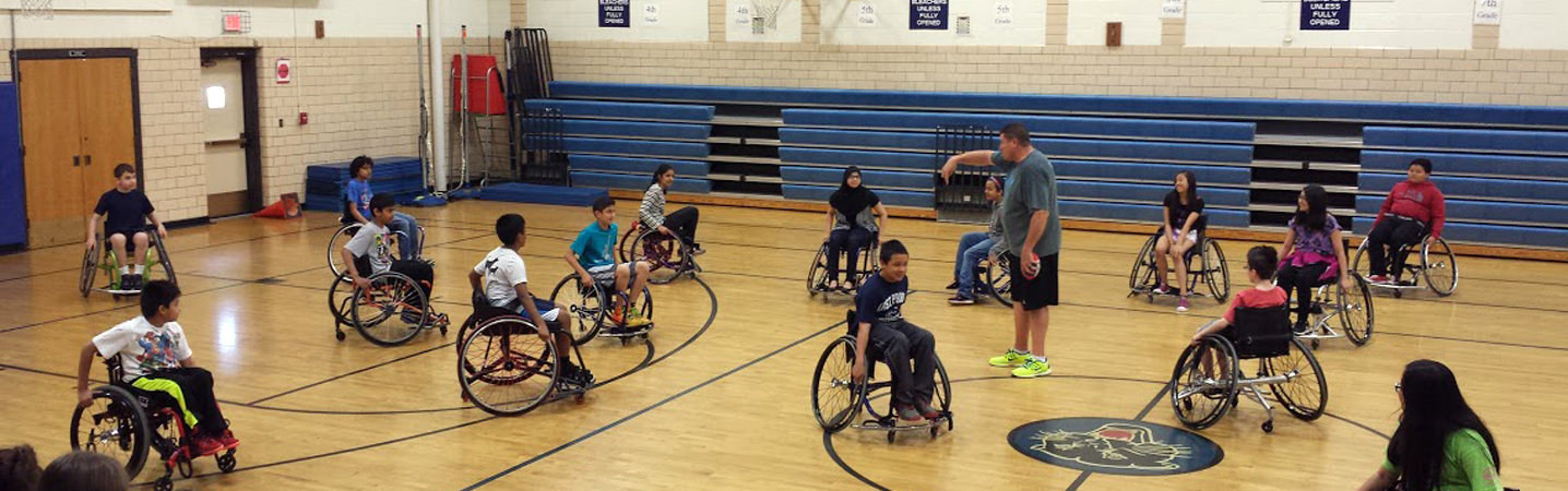 Kids Playing Wheelchair Basketball in School