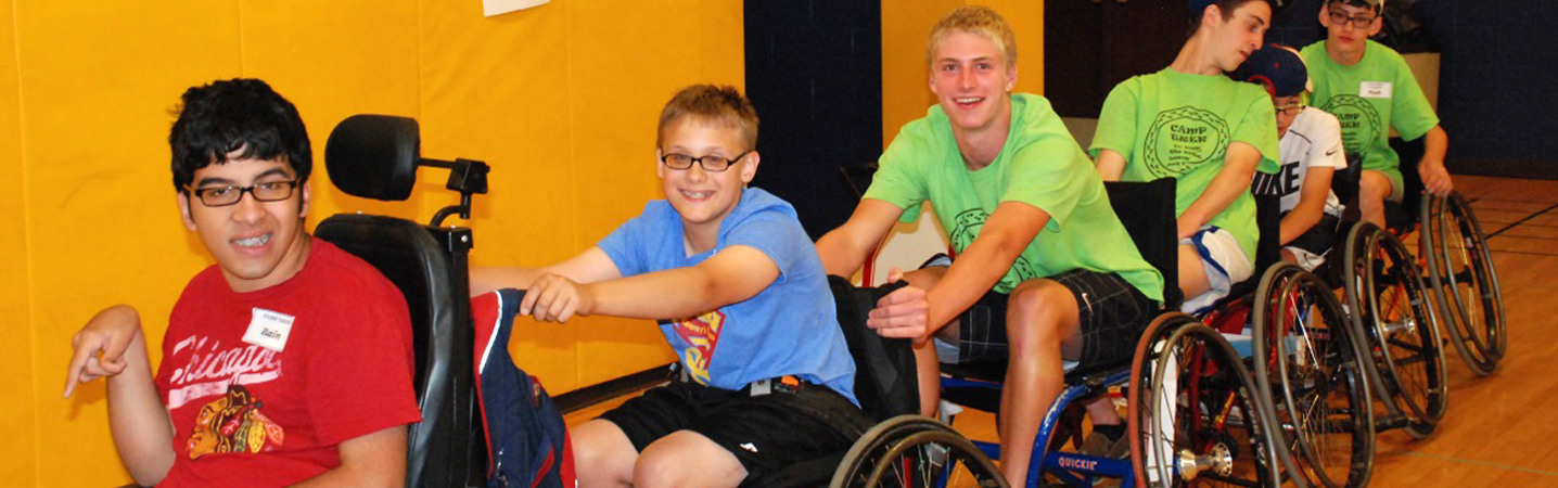Boys in a train of wheelchairs