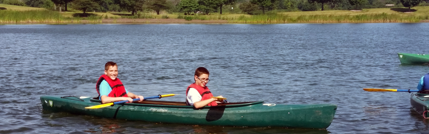 two boys kayaking at camp trek