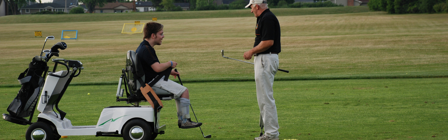 athlete receiving golf instruction