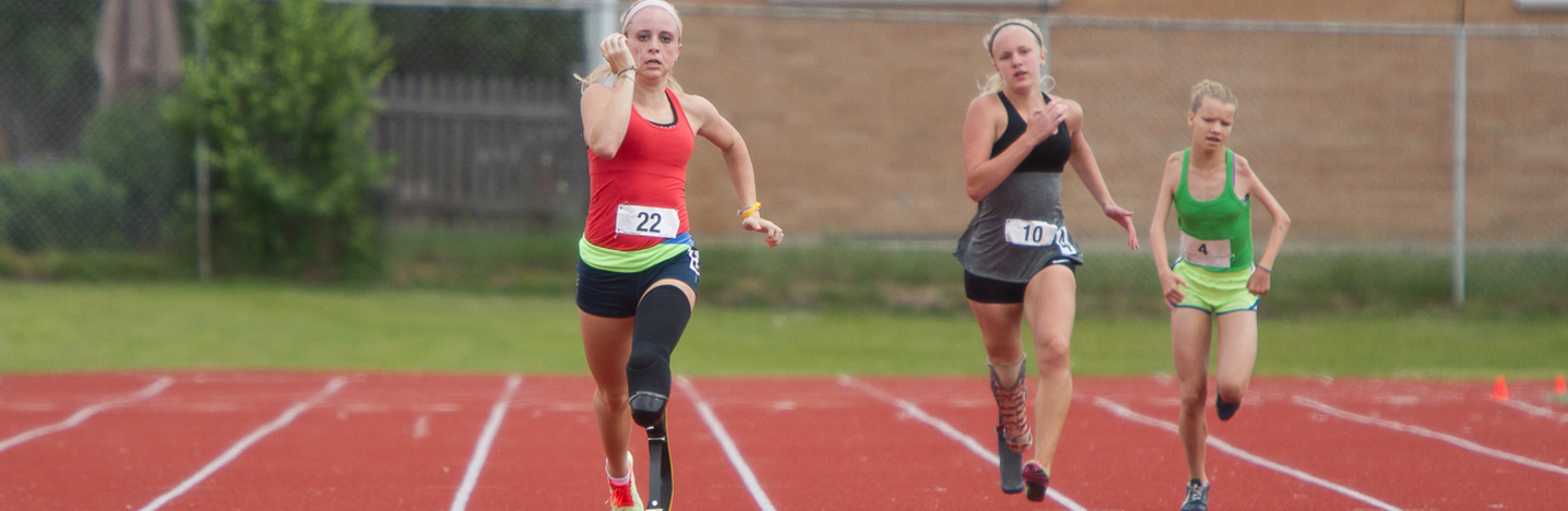 three amputee track runners